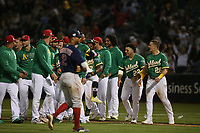 OAKLAND, CA - JULY 3:  Tony Kemp #5 and Elvis Andrus #17 of the Oakland Athletics celebrate after Kemp hit a game-winning sacrifice fly in the bottom of the 12th inning against the Boston Red Sox at the Oakland Coliseum on Saturday, July 3, 2021 in Oakland, California. (Photo by Brad Mangin)
