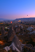 Hot air balloons fly in the morning over valley in Cappadocia, Turkey