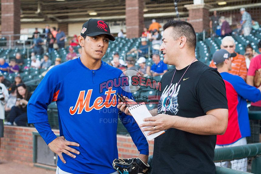 AFL East infielder Andres Gimenez (13), of the Scottsdale Scorpions and New York Mets organization, talks to a member of the media before the Arizona Fall League Fall Stars game at Surprise Stadium on November 3, 2018 in Surprise, Arizona. The AFL West defeated the AFL East 7-6 . (Zachary Lucy/Four Seam Images)
