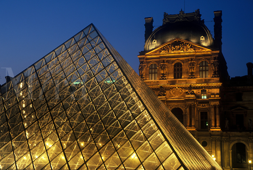 Louvre Museum and Glass Pyramid at dusk, Paris, France.
