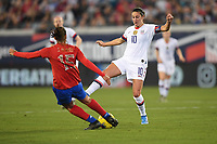 JACKSONVILLE, FL - NOVEMBER 10: Carli Loyd #10 of the United States defends her position from an advancing Stephannie Blanco #15 of Costa Rica during a game between Costa Rica and USWNT at TIAA Bank Field on November 10, 2019 in Jacksonville, Florida.