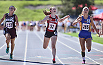 RAPID CITY, SD: MAY 26:   Makenna Larson, center, of Chester Area crosses the finish ahead of Dayna Roth, left, of Freeman and Rylie Brown of Lake Preston in the Class B Girls 100m  during the 2018 South Dakota State High School Track Meet at O'Harra Stadium in Rapid City, S.D.  (Photo by Dick Carlson/Inertia)