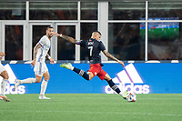 FOXOBOROUGH, MA - AUGUST 21: Gustavo Bou #7 of New England Revolution takes a shot on goal during a game between FC Cincinnati and New England Revolution at Gillette Stadium on August 21, 2021 in Foxoborough, Massachusetts.
