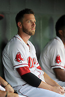 Boston Red Sox shortstop Stephen Drew (7) rests in the dugout between innings for the Class A Greenville Drive on a tuneup assignment in a game against the Augusta GreenJackets on Friday, May 23, 2014, at Fluor Field at the West End in Greenville, South Carolina. (Tom Priddy/Four Seam Images)