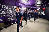 ORLANDO, FL - NOVEMBER 15: Cristian Roldan #10 of the United States walks through the tunnel out to the field during a game between Canada and USMNT at Exploria Stadium on November 15, 2019 in Orlando, Florida.