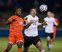 Phanuel Kavita (18) of Clemson closes in on the ball with Jake Pace (20) of Maryland during the game at the Maryland SoccerPlex in Germantown, MD. Maryland defeated Clemson, 1-0, in overtime.  With the win the Terrapins advanced to the finals of the ACC men's soccer tournament.