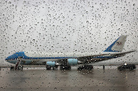 """Air Force One is seen through a car window under a heavy rain at Andrews Air Force Base on March 31, 2021 in Maryland. - US President Joe Biden is traveling to Pittsburgh, Pennsylvania to deliver remarks on his economic vision for the future and the Biden-Harris administration's plan to """"Build Back Better"""" for the American people.<br /> CAP/MPI/RS<br /> ©RS/MPI/Capital Pictures"""