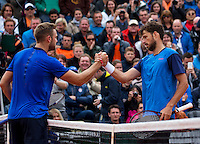 Paris, France, 23 june, 2016, Tennis, Roland Garros, Jack Sock (USA) left recieven congratulations from Robin Haase (NED, Sock won in five sets after several rain delays<br /> Photo: Henk Koster/tennisimages.com