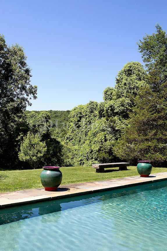 luxury pool area<br /> <br /> Real estate developer's home on 60 acres in Sherman Connecticut.   The original 1960's house of 2300 sq. ft. has undergone many renovations and additions to become a luxury gated residence with a large fish pond, tennis court and guesthouse on the premises.