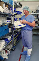Man in sterile attire working in hospital central supply area. Medical. Health care. Career. Occupation. hospital.