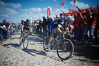 Tom Boonen (BEL/Etixx-QuickStep) tries to catch Sep Vanmarcke (BEL/LottoNL-Jumbo) who rode away earlier on the infamous Carrefour de l'Arbre (2.1 km). With Ian Stannard (GBR/Sky) tailing him.<br /> <br /> 114th Paris-Roubaix 2016