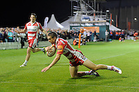 20130809 Copyright onEdition 2013 ©<br /> Free for editorial use image, please credit: onEdition.<br /> <br /> Steph Reynolds of Gloucester Rugby 7s dives over to score a try during the finals of the J.P. Morgan Asset Management Premiership Rugby 7s Series.<br /> <br /> The J.P. Morgan Asset Management Premiership Rugby 7s Series kicked off for the fourth season on Thursday 1st August with Pool A at Kingsholm, Gloucester with Pool B being played at Franklin's Gardens, Northampton on Friday 2nd August, Pool C at Allianz Park, Saracens home ground, on Saturday 3rd August and the Final being played at The Recreation Ground, Bath on Friday 9th August. The innovative tournament, which involves all 12 Premiership Rugby clubs, offers a fantastic platform for some of the country's finest young athletes to be exposed to the excitement, pressures and skills required to compete at an elite level.<br /> <br /> The 12 Premiership Rugby clubs are divided into three groups for the tournament, with the winner and runner up of each regional event going through to the Final. There are six games each evening, with each match consisting of two 7 minute halves with a 2 minute break at half time.<br /> <br /> For additional images please go to: http://www.w-w-i.com/jp_morgan_premiership_sevens/<br /> <br /> For press contacts contact: Beth Begg at brandRapport on D: +44 (0)20 7932 5813 M: +44 (0)7900 88231 E: BBegg@brand-rapport.com<br /> <br /> If you require a higher resolution image or you have any other onEdition photographic enquiries, please contact onEdition on 0845 900 2 900 or email info@onEdition.com<br /> This image is copyright the onEdition 2013©.<br /> <br /> This image has been supplied by onEdition and must be credited onEdition. The author is asserting his full Moral rights in relation to the publication of this image. Rights for onward transmission of any image or file is not granted or implied. Changing or deleting Copyright information is illegal as specified in the Copyright, Design and Patents Act 1988. If you are in any way unsure of your right to publish t