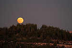 The Judean mountains, Israel. A view from Belmont Mount Tzuba of a full moon rising<br />