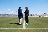 North Carolina head coach Anson Dorrance and Washington Spirit head coach Mike Jorden talk on the sideline before the game at the Maryland SportsPlex in Boyds, MD.  The Washington Spirit defeated the North Carolina Tar Heels in a preseason exhibition, 2-0.