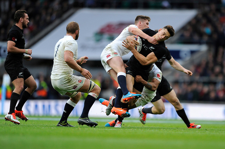 Sonny Bill Williams of New Zealand is tackled by Owen Farrell of England during the QBE International match between England and New Zealand at Twickenham Stadium on Saturday 8th November 2014 (Photo by Rob Munro)