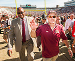 Florida State head coach Jimbo Fisher, right, and athletic director Stan Wilcox leave the field after an NCAA college football game against Louisville in Tallahassee, Fla., Saturday, Oct. 17, 2015. Florida State defeated Louisville 41-21. Florida State defeated Louisville 41-21. (AP Photo/Mark Wallheiser)