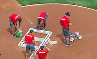 23 August 2015: Washington Nationals Grounds-crew prepare the home plate area prior to a game against the Milwaukee Brewers at Nationals Park in Washington, DC. The Nationals defeated the Brewers 9-5 in the third game of their 3-game weekend series. Mandatory Credit: Ed Wolfstein Photo *** RAW (NEF) Image File Available ***