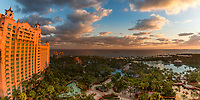 Aerial, sunset golden hour light on the famous Atlantis Resort and its lush gardens and pools, on Paradise Island, near Nassau, Bahamas