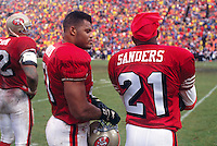 SAN FRANCISCO, CA - Ken Norton Jr. and Deion Sanders of the San Francisco 49ers talk on the sidelines during a game at Candlestick Park in San Francisco, California in 1994. Photo by Brad Mangin