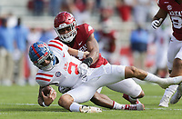 Arkansas defensive lineman Julius Coates (13) sacks Ole Miss quarterback Matt Corral (2), Saturday, October 17, 2020 during the first quarter of a football game at Donald W. Reynolds Razorback Stadium in Fayetteville. Check out nwaonline.com/201018Daily/ for today's photo gallery. <br /> (NWA Democrat-Gazette/Charlie Kaijo)