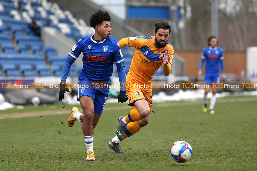 Courtney Senior of Colchester United and Stephen McLaughlin of Mansfield Town during Colchester United vs Mansfield Town, Sky Bet EFL League 2 Football at the JobServe Community Stadium on 14th February 2021