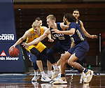 SIOUX FALLS, SD - MARCH 9: Francis Lacis #22 of the Oral Roberts Golden Eagles reaches on Sam Griesel #5 of the North Dakota State Bison during the 2021 Men's Summit League Basketball Championship at the Sanford Pentagon in Sioux Falls, SD. (Photo by Richard Carlson/Inertia)