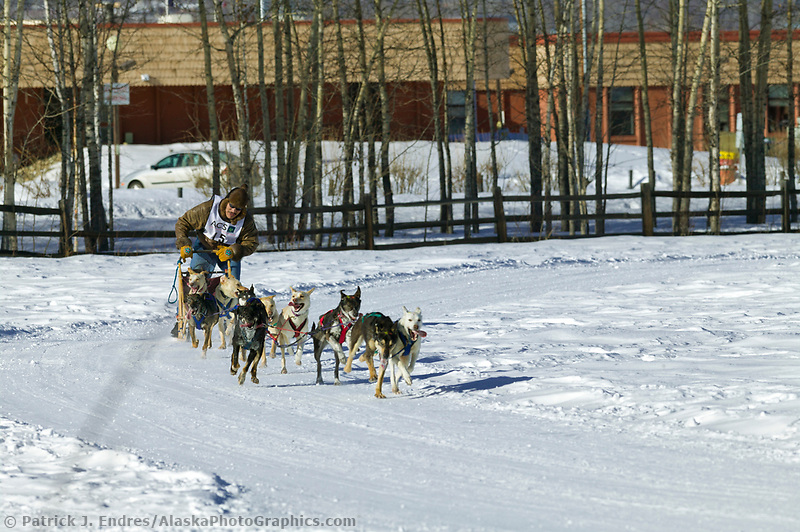 Musher Ricky Vent passes Creamers Field on day three of the oldest continuously run sled dog race in the world, the 2003 Open North American Sled dog championships, Fairbanks, Alaska. The annual race consists of three daily races, the combined fastest time wins.