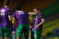 20th April 2021; Carrow Road, Norwich, Norfolk, England, English Football League Championship Football, Norwich versus Watford; Oliver Skipp of Norwich City takes on fluids before kick off