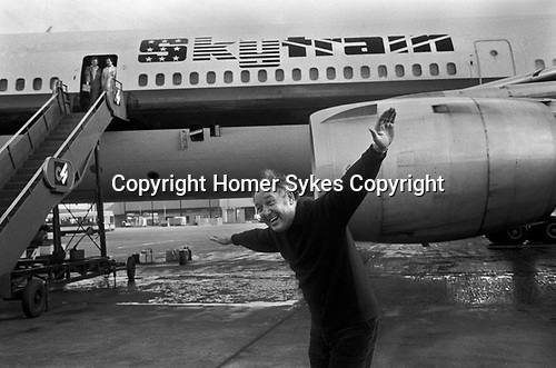 Freddie Laker launched Skytrain, the inaugural flight took place amongst much hype on 26th September 1977. This was a no frills low fare, budget daily service between London Gatwick and JFK in New York.<br /> Freddie Laker meets the press; his normal pose for photographers was with his arms outstretched pretending to be one of his aircraft.