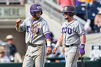 TCU Horned Frogs outfielder Dane Steinhagen (10) and catcher Evan Skoug (9) after scoring against the LSU Tigers in the NCAA College World Series on June 14, 2015 at TD Ameritrade Park in Omaha, Nebraska. TCU defeated LSU 10-3. (Andrew Woolley/Four Seam Images)