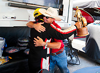 Jul 12, 2020; Clermont, Indiana, USA; NHRA top fuel driver Billy Torrence (left) celebrates with son Steve Torrence after winning the E3 Spark Plugs Nationals at Lucas Oil Raceway. This is the first race back for NHRA since the start of the COVID-19 global pandemic. Mandatory Credit: Mark J. Rebilas-USA TODAY Sports
