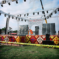 A couple of hours before the concert, a woman cleans the stage where different singers from Armenia and Karabakh will perform for the the celebration of the independance day.