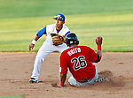 El Paso Diablos 1st Baseman Javier Brito (26) and Fort Worth Cats 2nd Baseman Cory Morales (18) in action during the American Association of Independant Professional Baseball game between the El Paso Diablos and the Fort Worth Cats at the historic LaGrave Baseball Field in Fort Worth, Tx. Fort Worth defeats El Paso 10 to 9.