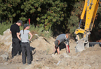Pictured: A digger assists forensics officers with the preliminary search at the new site in Kos, Greece. Friday 07 October 2016<br />