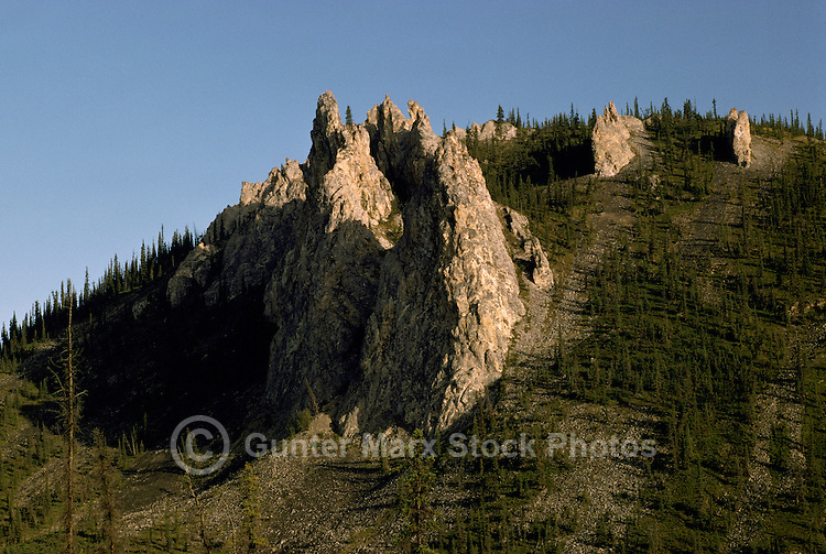 Rock Formations, Hoodoos, and Boreal Black Spruce Forest along Dempster Highway (Hwy 5), Yukon Territory, Canada - Midnight Sun