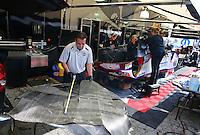 Feb 8, 2014; Pomona, CA, USA; Tony Pedregon works with crew members doing some fiberglass work on the NHRA funny car body during qualifying for the Winternationals at Auto Club Raceway at Pomona. Mandatory Credit: Mark J. Rebilas-