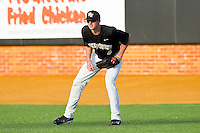 Right fielder Zane Yanzick #4 of the Wake Forest Demon Deacons on defense against the Miami Hurricanes at Gene Hooks Field on March 19, 2011 in Winston-Salem, North Carolina.  Photo by Brian Westerholt / Four Seam Images