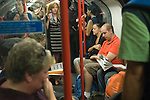 London underground people travelling on the tube. England