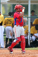 Philadelphia Phillies catcher Francisco Diaz #84 after throwing a warmup throw to second during an Instructional League game against the Pittsburgh Pirates at Pirate City on October 11, 2011 in Bradenton, Florida.  (Mike Janes/Four Seam Images)