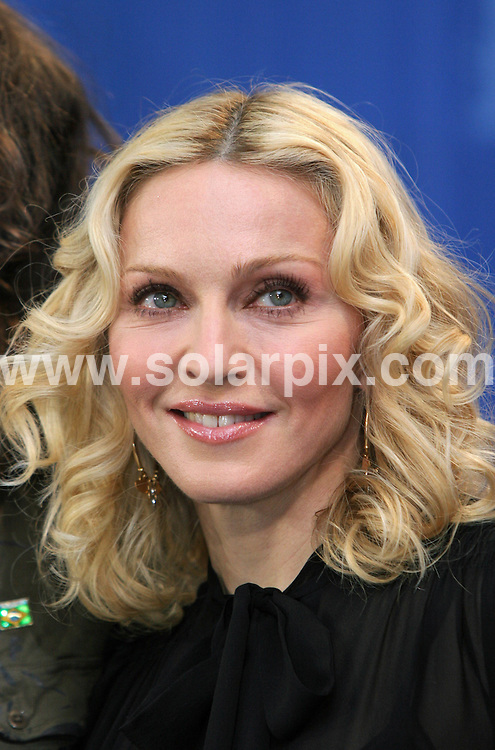 """**ALL ROUND PICTURES FROM SOLARPIX.COM**.**SYNDICATION RIGHTS FOR UK AND SPAIN ONLY**.Madonna during the photocall """"Filth And Wisdom"""" at the 58th Berlin Film Festival (Berlinale) in Berlin, Germany. 13th February 2008..This pic: Madonna..JOB REF: 5782  CPR        DATE: 13_02_2008.**MUST CREDIT SOLARPIX.COM OR DOUBLE FEE WILL BE CHARGED* *UNDER NO CIRCUMSTANCES IS THIS IMAGE TO BE REPRODUCED FOR ANY ONLINE EDITION WITHOUT PRIOR PERMISSION*"""