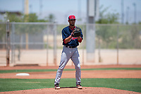 Cleveland Indians relief pitcher Yeffersson Yannuzzi (45) checks the runner at first base during an Extended Spring Training game against the Arizona Diamondbacks at the Cleveland Indians Training Complex on May 27, 2018 in Goodyear, Arizona. (Zachary Lucy/Four Seam Images)