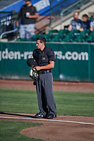 Umpire John Perez handles the calls behind the plate during the game between the Ogden Raptors and the Missoula Osprey at Lindquist Field on July 12, 2018 in Ogden, Utah. Missoula defeated Ogden 11-4. (Stephen Smith/Four Seam Images)