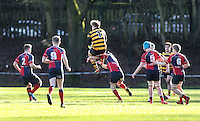 Saturday 4th February 2017 | RBAI vs BALLYCLARE HIGH SCHOOL<br /> <br /> Callum Reid is taken out in the air during the Ulster Schools' Cup clash between RBAI and Ballyclare High School at  Cranmore Park, Belfast, Northern Ireland.<br /> <br /> Photograph by www.dicksondigital.com