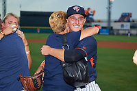 Tampa Yankees pitcher Andrew Schwaab (34) and his fiancé Lauren Stoeckle hug family after proposing before the Florida State League All-Star Game on June 17, 2017 at Joker Marchant Stadium in Lakeland, Florida.  FSL North All-Stars defeated the FSL South All-Stars  5-2.  (Mike Janes/Four Seam Images)