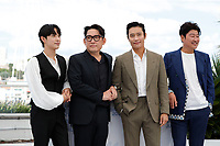 """CANNES, FRANCE - JULY 16: (L to R) Yim Si-wan, Director Han Jae-rim, Lee Byung-hun and Song Kang-ho at the """"Bi-Sang-Seon-Eon/Emergency Declaration"""" photocall during the 74th annual Cannes Film Festival on July 16, 2021 in Cannes, France. <br /> CAP/GOL<br /> ©GOL/Capital Pictures"""