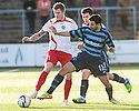 Stranraer's Willie Gibson is challenged by Forfar's Omar Kader.