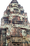 Angkorian temple Banteay Srei (late 10th century) 967.<br /> North sanctuary tower north face shows Kubera on the pediment and Krishna killing a demon on the lintel.<br /> Banteay Srei temple has three sanctuary towers.The central sanctuary and the southern sanctuary were dedicated to Shiva and the northern sanctuary was dedicated to Vishnu.<br /> Banteay Srei temple is situated 20km north of Angkor, built during the reign of Rajendravarman by Yajnavaraha, one of his counsellors. In antiquity Isvarapura was a small city that grew up around the temple. Banteay Srei was dedicated to the worship of Shiva, the foundation stele describes the consecration of the linga Tribhuvanamahesvara (Lord of the three worlds) in 967.