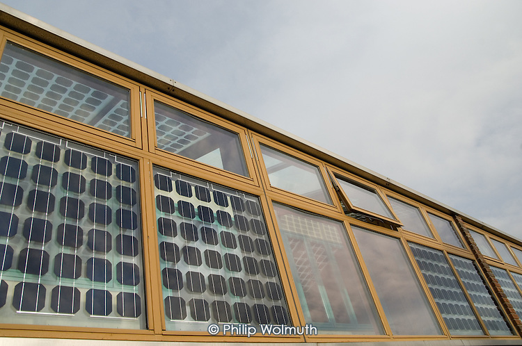 Solar panels on the south-facing wall of a building at the Beddington Zero Energy Development (BedZED) in the London Borough of Sutton.  BedZED, the UK's largest carbon-neutral eco-community, comprises 82 mixed tenure housing units, managed by the Peabody Trust, and north-facing offices.