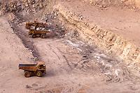Arlit, Niger.  Ore Movers Excavating in Open-pit Uranium Mine.