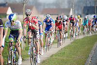 thumbs up now for Marcel Sieberg (DEU/Lotto-Belisol) using the bikepath next to the cobbles after he justifiably questioned the new dubious UCI rules regarding after Omloop het Nieuwsblad just a few weeks earlier<br /> <br /> 57th E3 Harelbeke 2014